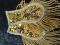 Epauletten-in-pailletenstof-goud-en-zilver